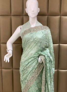 Mesmeric Brasso Net Party Designer Saree